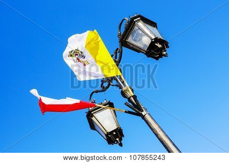 Two Flags Mounted On A Lamppost