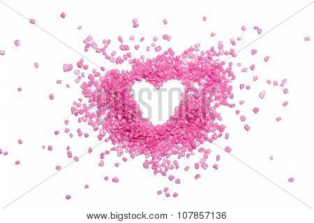 Heart shape from pink candies on white background