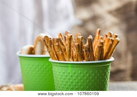 Disposable Green Cups With Breadstuffs