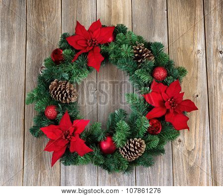 Holiday Poinsettia Christmas Wreath On Rustic Wooden Boards