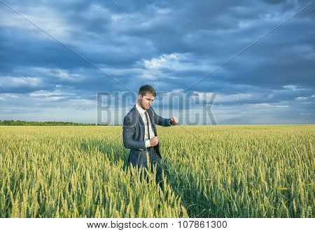 young business man think look up hold tablet pc computer