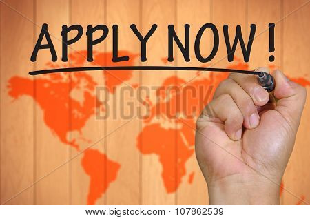 Hand Writing Apply Now Over Blur World Background