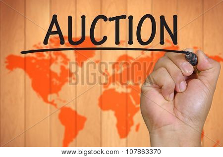 Hand Writing Auction Over Blur World Background