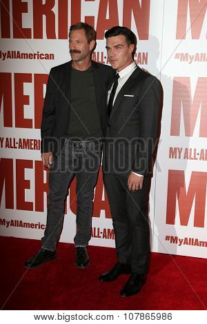 LOS ANGELES - NOV 9:  Aaron Eckhart, Finn Wittrock at the