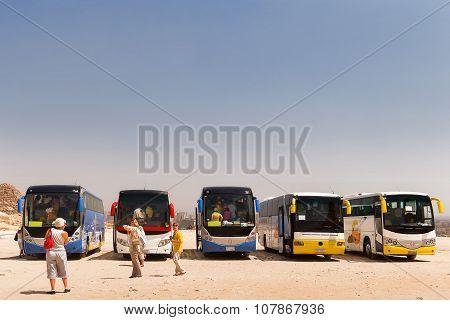 Giza, Egypt - September 11, 2008. Tourists Stay Near Pyrimides Of Gyza And Touristic Buses.