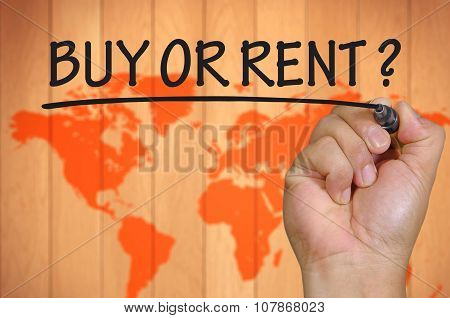 Hand Writing Buy Or Rent Over Blur World Background