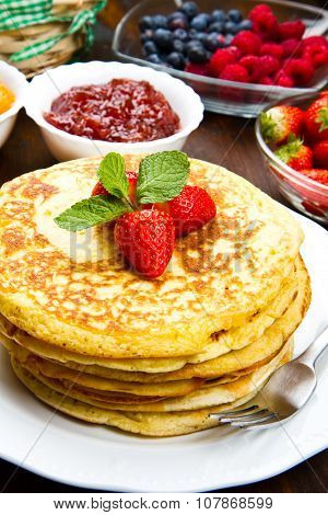 Delicious Pancakes On Wooden Table With Fruits
