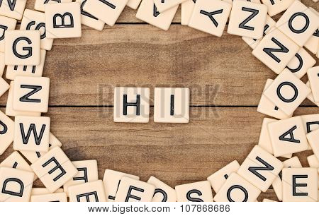 Hi Spelled Out In Tan Tile Letters