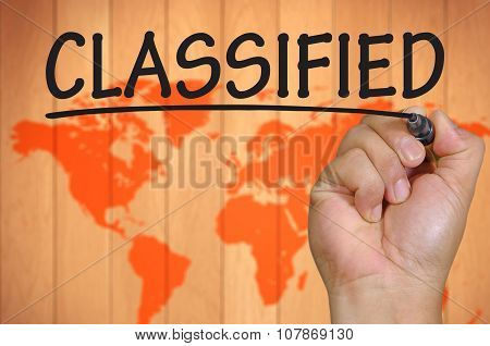 Hand Writing Classified Over Blur World Background