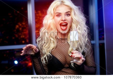 Young celebrating woman black dress . Beautiful model  hold wine glass.
