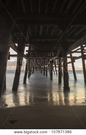 Under the San Clemente pier at sunset