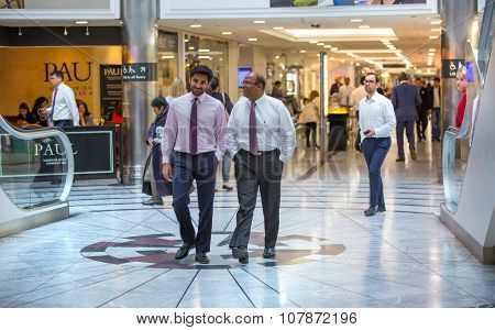 London, Business people walking in Canary Wharf at lunch time break.