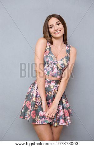 Portrait of young content joyful beautiful cute shy pretty girl in summer floral suit