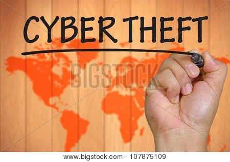 Hand Writing Cyber Theft Over Blur World Background