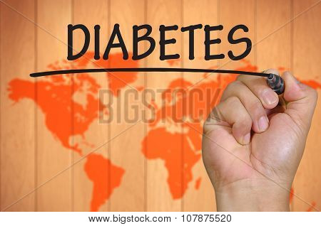 Hand Writing Diabetes Over Blur World Background