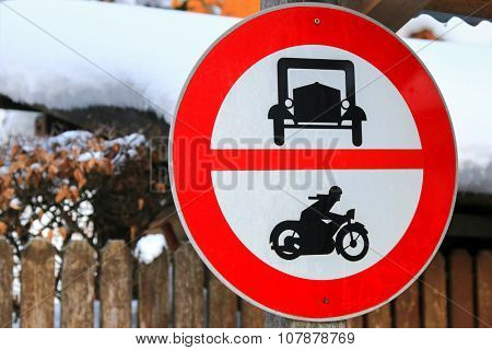 A road sign for no entry for cars and motorbikes at Hallstatt, Austria during Winter season