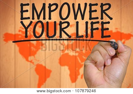 Hand Writing Empower Your Life Over Blur World Background