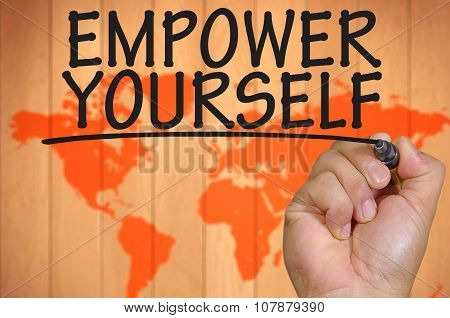 Hand Writing Empower Yourself Over Blur World Background