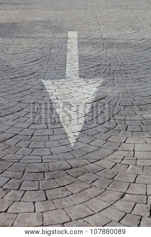 White arrow on a grey road with texture