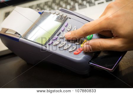 Close Up Of Hand With Credit Card Swipe Through Terminal For Sale In Store