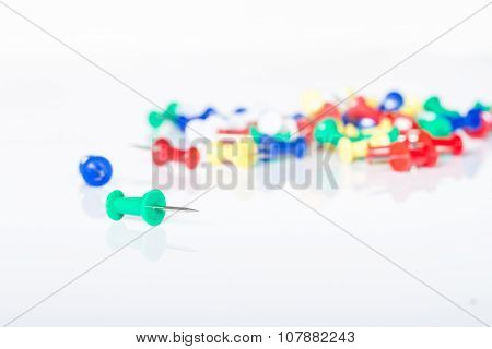 Pins for sticky paper on white background