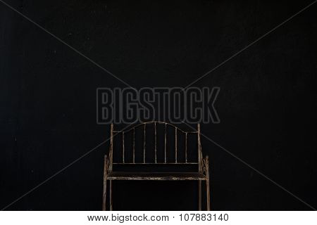 Vintage metal chair in black background