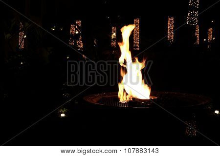 Fire pit in lights background