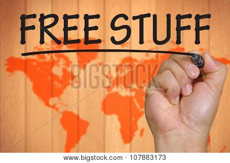 Hand Writing Free Stuff Over Blur World Background