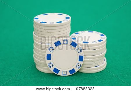 Lots Of White Poker Chips On Green Casino Table