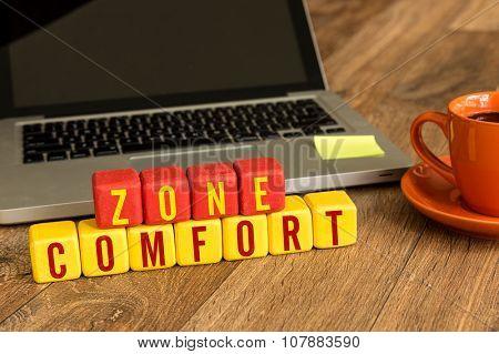 Comfort Zone written on a wooden cube in office desk