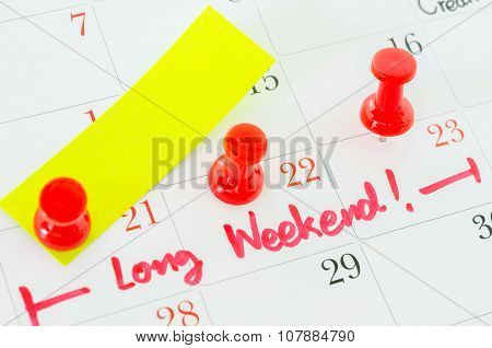 The Words Long Weekend Written On A White Calendar.