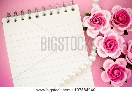Roses And Open Notebook.
