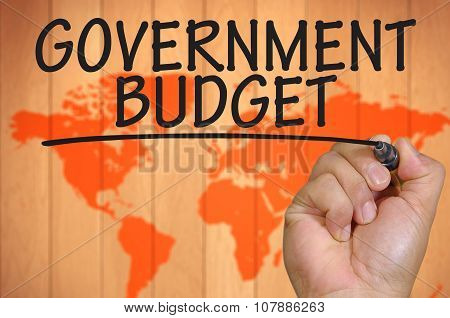 Hand Writing Government Budget Over Blur World Background