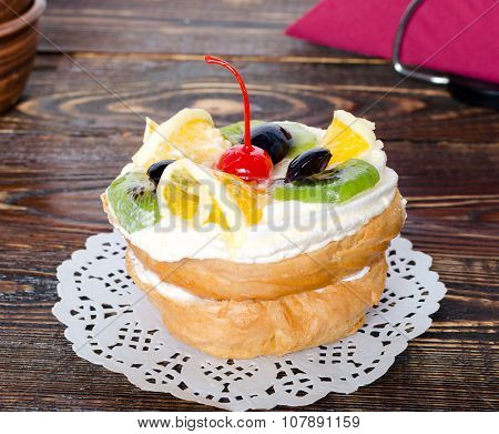 Choux Pastry With Fruit On A Wooden Background