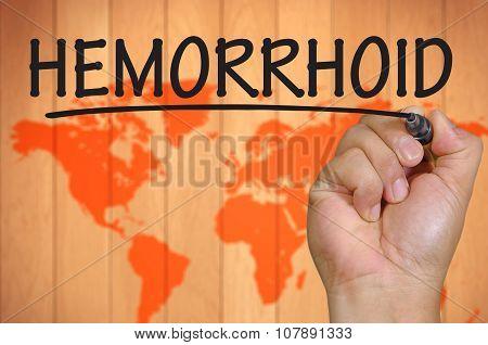 Hand Writing Hemorrhoid Over Blur World Background