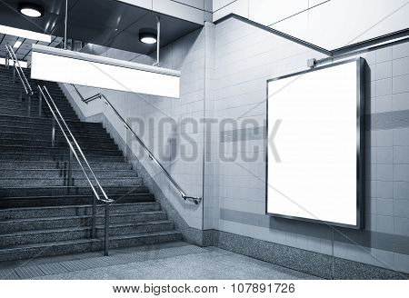 Billboard and direction signage mock up in subway with stairs