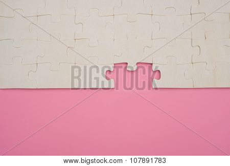 Jigsaw Puzzle With One Piece Missed On Pink Background