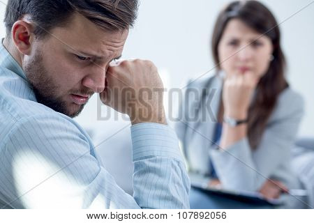 Resigned Man At Psychiatrist's Office