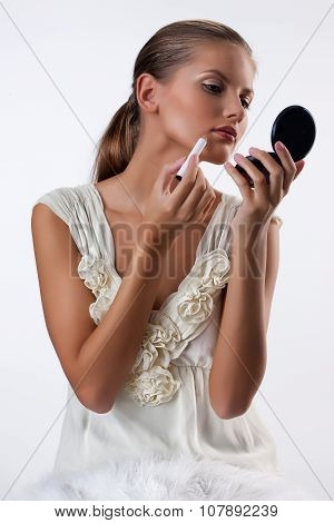 Young Woman Applying Cosmetics