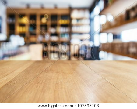 Table Top Counter With Blur Shlef Product Display Interior Of Retail Shop Background