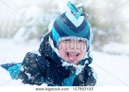 Happy boy in the snow outdoor