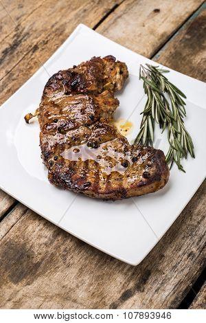 Beefsteak On White Dish On Wooden Background