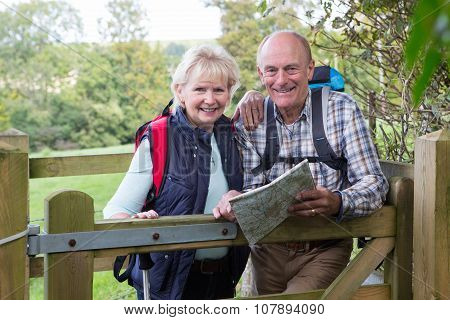 Active Senior Couple On Walk In Countryside