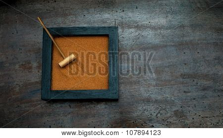Zen Garden With Rake On Orange Sand