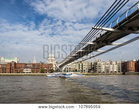 London skyline with Millenium bridge seen from Thames