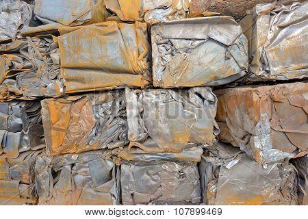 Compressed packages blocks scrap of metal