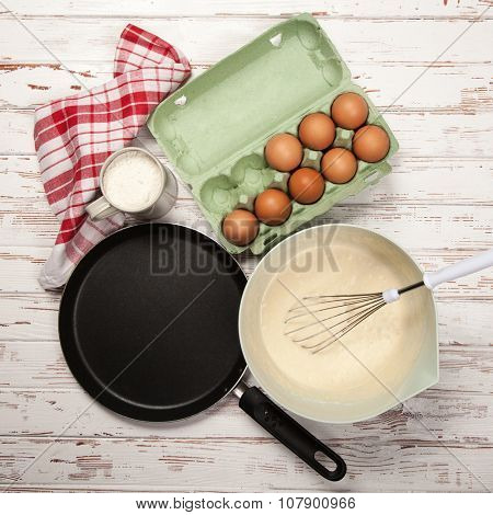 Preparing batter for pancakes - eggs, flour, milk