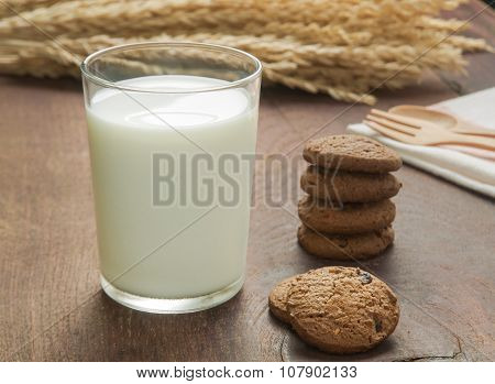 Soy milk and Chocolate chip cookies on wood table background .