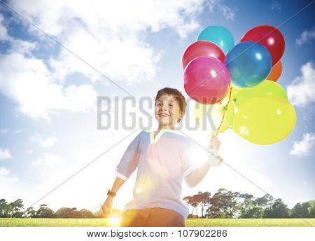 Happy Boy Outdoors Dozen Helium Balloons Playful Concept