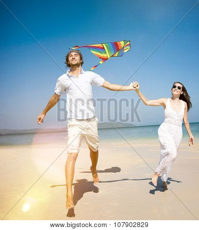 Playing Kite Couple Relaxing Beach Carrying Summer Concept